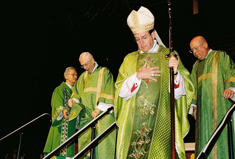 Deacon Bill and Bishop Vigneron descend from the stage