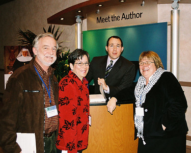 """Raymond Arroyo, EWTN news director and author of Morther Angelica: The Remarkable Story of a Nun, Her Nerve, and a Network of Miracles with Bob and Mary Jo Wieland and Roseanne Sullivan (me)  While he signed my book,  I told him people were saying he is a riot, and he told me he has started a few.  A man came up to me at the event and said, """"Thanks for wearing the Kefiyah. I'm Palestinian too."""" I said, """"You're welcome.  I hope it's not offensive that I'm wearing it."""" No, he was happy to see me wearing the scarf that I bought from a street vendor in Bethlehem.  Mary Jo said that when an acquaintance of ours that we met at the event (who is over 70) went to get her book signed, Raymond said, """"How are you,  darlin?"""" And she said, """"Tired."""" He said, """"You think you're tired, I've been on a book signing tour for four months."""""""
