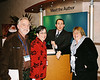 "Raymond Arroyo, EWTN news director and author of Morther Angelica: The Remarkable Story of a Nun, Her Nerve, and a Network of Miracles with Bob and Mary Jo Wieland and Roseanne Sullivan (me)  While he signed my book,  I told him people were saying<br /> he is a riot, and he told me he has started a few.<br /> <br /> A man came up to me at the event and said, ""Thanks for wearing the<br /> Kefiyah. I'm Palestinian too."" I said, ""You're welcome.  I hope it's not<br /> offensive that I'm wearing it."" No, he was happy to see me wearing the<br /> scarf that I bought from a street vendor in Bethlehem.<br /> <br /> Mary Jo said that when an acquaintance of ours that we met at the event<br /> (who is over 70) went to get her book signed, Raymond said, ""How are you, <br /> darlin?"" And she said, ""Tired."" He said, ""You think<br /> you're tired, I've been on a book signing tour for four months."""
