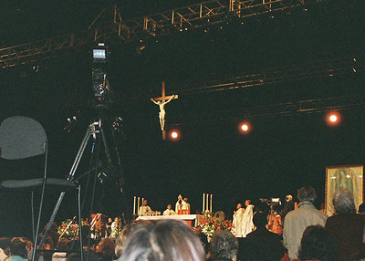 Fr. Francis Mary elevates the host at the consecration at Sat. Mass