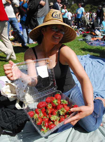 Generous strawberry woman at Earthday concert at GG Park