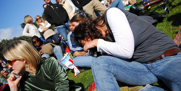 Stacey hides from photos at Earthday concert at GG Park