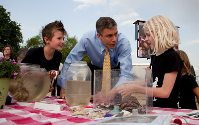 U.S. Sec. of Education Arne Duncan meets with Maya Willey and Jane Bodor of the No Child Left Inside Nature Club of Hlilsmere Elementary School of Annapolis, MD. and an eastern box turtle named Pumkin. On the National Mall in Washington DC. April 22, 2010 marked the 40th Anniversary of Earth Day. (Photo by Jeff Malet)