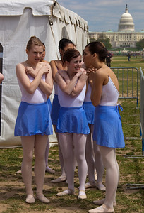 The Washington School of Ballet gets ready to perform on a cold afternnoon on the National Mall in Washington DC during Earth Day Celebrations. April 18, 2010. (Photo by Jeff Malet)