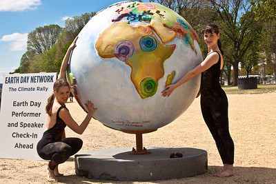 "CityDance dancers Kate Jordan and Kaitlin Madzelan. CityDance Ensemble performed their environmentally themed dance ""Perigrine"" on the National Mall in Washington DC during Earth Week Celebrations. Hot Ideas for a Cooler Planet, is a public art project designed to raise awareness on solutions for global warming. In Washington DC, ""Clinton's Climate Initiative"" globe by artist Sandra Bacon. April 18, 2010. (Photo by Jeff Malet)"