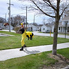 Record-Eagle/Keith King<br /> Reni Dengel, of Cedar, skates along Eighth Street ahead of the Traverse City Earth Day Parade Saturday, April 30, 2011 to stop traffic at the intersection of Eighth Street and Union Street.