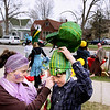 Record-Eagle/Keith King<br /> Hannah Flaugher, of Mesick, helps her brother, Enoch Flaugher, 13, put on a praying mantis-themed piece of headgear at Central Grade School Saturday, April 30, 2011 prior to the start of the Traverse City Earth Day Parade.