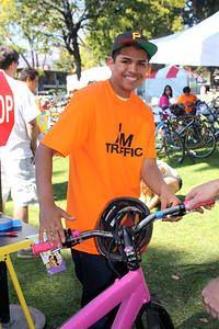 Miguel, Don's Net Cafe student and dedicated SBici volunteer, is parking bikes at Bike World