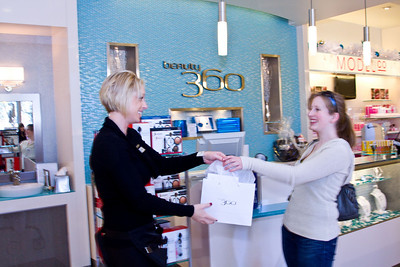 Sarah Ray, beauty consultant (L) with customer