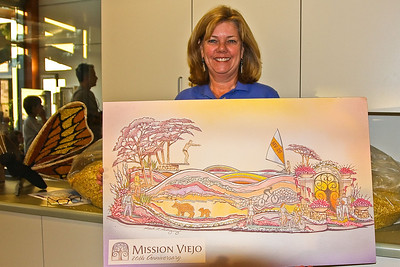 Kathi Dickey, Community Services Supervisor for the City of Missison Viejo, holding painting of what the finished float will look like.