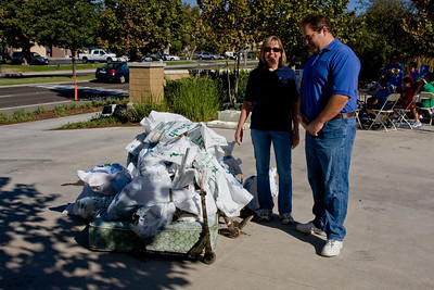 Denice Matson & Rick Schlesinger take a look at the trash pile