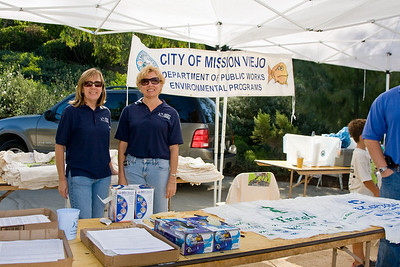Left: Denise Matson, Senior Management Analyst. Right: Deborah L. Carson: Program Engineer. Both with the Dept of Public Works for the City of MV, volunteering their week-end time.