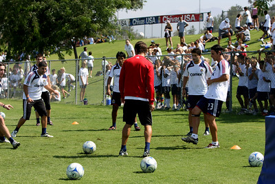 Aug 15, 2008. Soccer for Hope camp kids watch Chivas team practice.