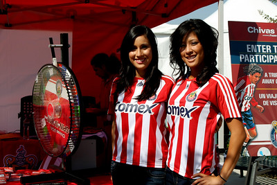 "Aug 15, 2008. The ""Chivas Girls"" at the official Chivas booth.  Lauren Morales (left), and Linette Fan (right)."
