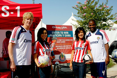 Aug 15, 2008. Chivas girls with Chivas players. Left to right: Jim Curtin, Lauren Morales, Linette Fan and Shavar Thomas.