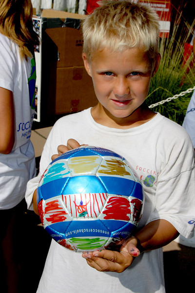 "Aug 15, 2008. Wes Henderson, age 8, shows his decorated soccer ball as part of ""Futbol 4 Refugees"". http://www.coronaunitedsoccer.org/index.php?ct=FutbolforRefugees"