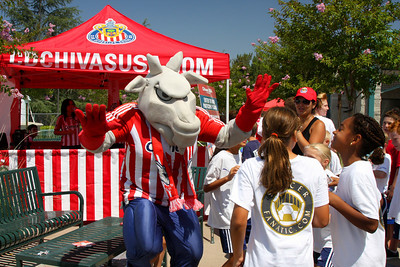 Aug 15, 2008. Chivas mascot dances with camp kids.