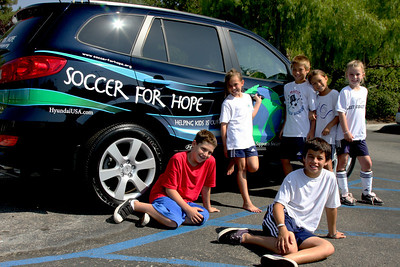 Aug 15, 2008. Camp kids with the official Soccer for Hope car.