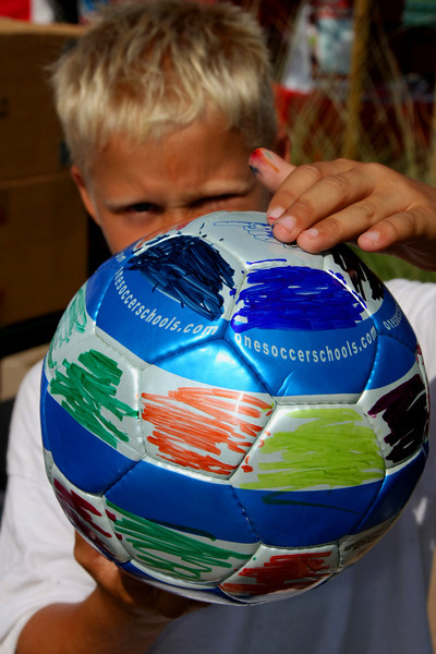 "Aug 15, 2008. Wes Henderson, age 8, shows his decorated soccer ball as part of the ""Futbol 4 Refugees"" non profit organization. Wes attends Glen Yermo Elementary School in Mission Viejo, CA. http://www.coronaunitedsoccer.org/index.php?ct=FutbolforRefugees"