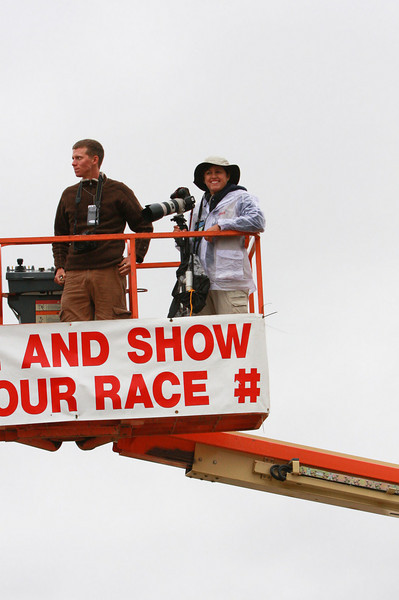 "Rock-n-Roll Marathon 2009, San Diego. About 20 feet in the air, shooting the runners as they pass below us, at mile 21, across from Sea World. Cloudy and expecting light drizzles. The complete sign read...""Smile and show us your race #""."