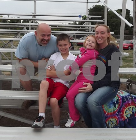 """From left to right: Corey Anderson, Blain Anderson, Hazey Slawson, and Tracey Jirard. """"Go Scotty Slawson."""""""