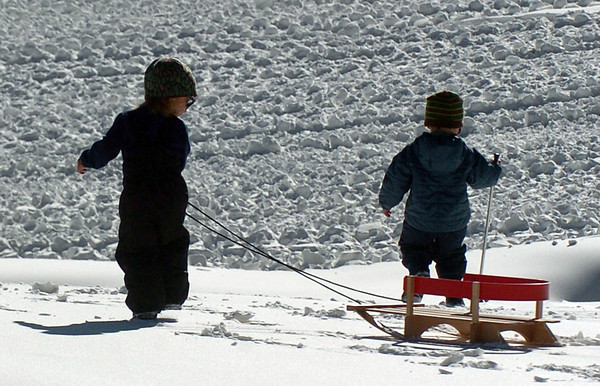 Bode Bodan, 2, left,  and Noah Bachman, are taking their sled and going home.<br /> Friday, November 20, 2009, was opening day at the Eldora Mountain Resort.<br /> Cliff Grassmick / November 20, 2009