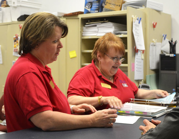 Diane Raver | The Herald-Tribune<br /> Ripley County Clerk's Office second deputy Vickie Hon and election clerk Diane Macek look over election results.
