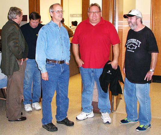 Debbie Blank   The Herald-Tribune<br /> John Worth (from left), Franklin County Republican Party chair, chats with Commissioner Tom Wilson while council members Daryl Kramer, Joe Sizemore, up for re-election, and Dean McQueen watch early returns on a courthouse lobby wall.