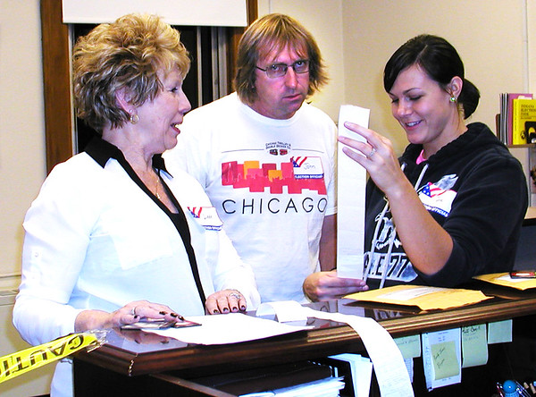 Debbie Blank | The Herald-Tribune<br /> In the Franklin County clerk's office, John Cairns (middle), Holton, a representative of Governmental Business Systems, Illinois, voting machines, matches up computer memory cards with voting printouts with the help of Democratic election board member Linda Vaughn (left) and clerk's first deputy Jenna Simmermeyer.