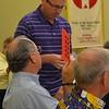 Fr. Greg distributes ballots