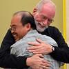 Fr. Ed congratulates Fr. Quang on his election