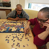 Jose Ortiz and Isabel Rivera, both of Lowell, work on a jigsaw puzzle during Khmer New Year celebration at Element Care in Lowell. (SUN/Julia Malakie)