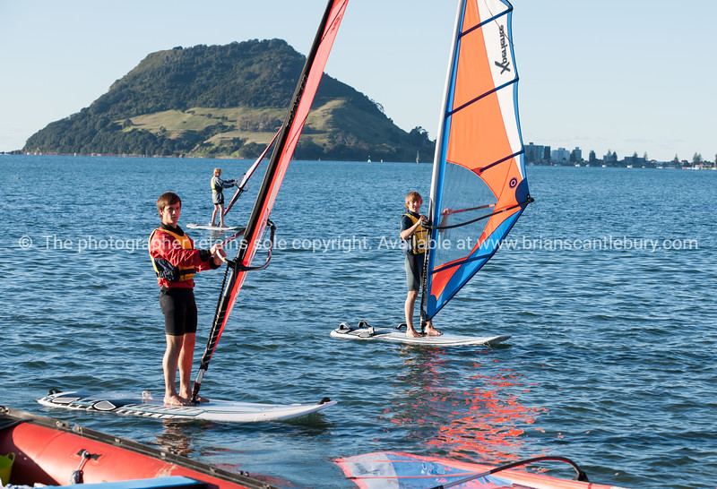 """Windsurfing, Elements Watersports. Model Release; No, editorial or personal use only. Windsurfing lessons Also see; <a href=""""http://www.blurb.com/b/3811392-tauranga"""">http://www.blurb.com/b/3811392-tauranga</a> Also see; <a href=""""http://www.blurb.com/b/3811392-tauranga"""">http://www.blurb.com/b/3811392-tauranga</a> Tauranga photographer,Tauranga photos, photos of Tauranga"""