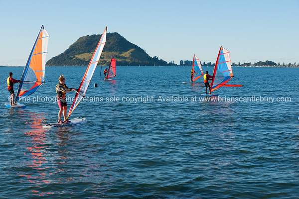 """Windsurfing, Elements Watersports.<br />  Model Release; No, editorial or personal use only. Windsurfing lessons Also see; <a href=""""http://www.blurb.com/b/3811392-tauranga"""">http://www.blurb.com/b/3811392-tauranga</a> Also see; <a href=""""http://www.blurb.com/b/3811392-tauranga"""">http://www.blurb.com/b/3811392-tauranga</a> Tauranga photographer,Tauranga photos, photos of Tauranga"""