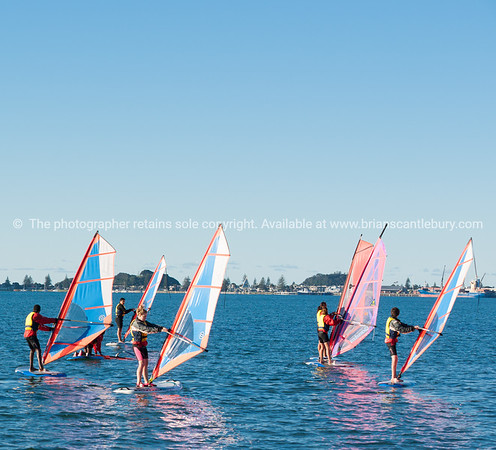 """Windsurfing lessons<br /> Windsurfing, Elements Watersports. <br /> Model Release; No, editorial or personal use only. Windsurfing lessons Also see; <a href=""""http://www.blurb.com/b/3811392-tauranga"""">http://www.blurb.com/b/3811392-tauranga</a> Also see; <a href=""""http://www.blurb.com/b/3811392-tauranga"""">http://www.blurb.com/b/3811392-tauranga</a> Tauranga photographer,Tauranga photos, photos of Tauranga"""