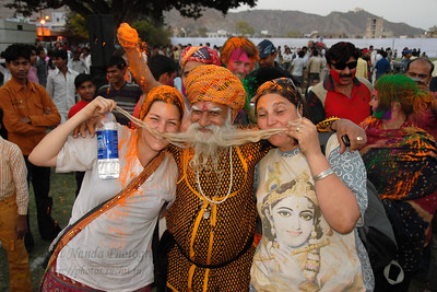 Tourists having a great time at the event.   Elephant Festival 2009 being celebrated in Jaipur on 10th Mach 2009. The elephant festival, Jaipur (Hindi: जयपुर),, is one of the most fascinating events organized in Rajasthan. This one day event coincides with Holi, the Indian festival of colors. The handlers or mahouts decorate their elephants in regal attire, and make them walk in procession at the start of the day. The procession heads to the Chaugan, the vast ground in Jaipur where this festival is hosted. The procession is watched by thousands of tourists and locals. Jaipur, Rajasthan, India.