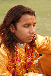 Candid portrait of one of the male performers at Elephant Festival 2009 which was being celebrated in Jaipur on 10th Mach 2009. The elephant festival, Jaipur (Hindi: जयपुर),, is one of the most fascinating events organized in Rajasthan. This one day event coincides with Holi, the Indian festival of colors. The handlers or mahouts decorate their elephants in regal attire, and make them walk in procession at the start of the day. The procession heads to the Chaugan, the vast ground in Jaipur where this festival is hosted. The procession is watched by thousands of tourists and locals. Jaipur, Rajasthan, India.