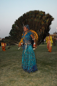 Peacock feather dance with the moon at the back. Dance performance at the Elephant Festival 2009 which was being celebrated in Jaipur on 10th Mach 2009. The elephant festival, Jaipur (Hindi: जयपुर),, is one of the most fascinating events organized in Rajasthan. This one day event coincides with Holi, the Indian festival of colors. The handlers or mahouts decorate their elephants in regal attire, and make them walk in procession at the start of the day. The procession heads to the Chaugan, the vast ground in Jaipur where this festival is hosted. The procession is watched by thousands of tourists and locals. Jaipur, Rajasthan, India.