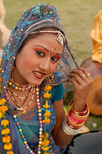 Candid portrait of the performers at Elephant Festival 2009 which was being celebrated in Jaipur on 10th Mach 2009. The elephant festival, Jaipur (Hindi: जयपुर),, is one of the most fascinating events organized in Rajasthan. This one day event coincides with Holi, the Indian festival of colors. The handlers or mahouts decorate their elephants in regal attire, and make them walk in procession at the start of the day. The procession heads to the Chaugan, the vast ground in Jaipur where this festival is hosted. The procession is watched by thousands of tourists and locals. Jaipur, Rajasthan, India.