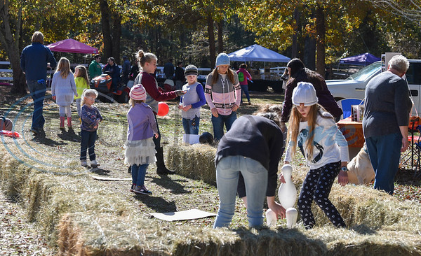 Children play on hay bales on Saturday while attending Elijah's Retreat Fall Festival. The event was a celebration of the retreat's 10th year in business. (Jessica T. Payne/Tyler Morning Telegraph)