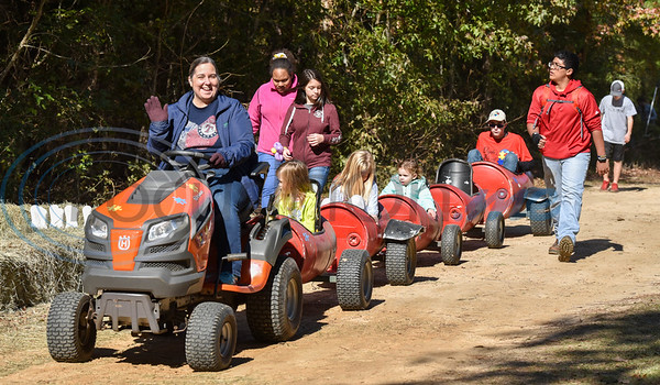 Pam Anderson with Calvary Baptist Church smiles while driving a children's train at the Elijah's Retreat Fall Festival in Jacksonville. The Saturday event included auctions, bounce houses, bean bag toss, face painting, petting zoo and more. (Jessica T. Payne/Tyler Morning Telegraph)