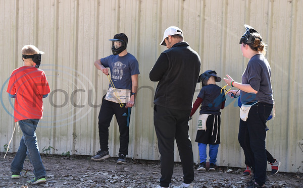 """Children get ready to play a game of """"yard battle"""" at the Elijah's Retreat Fall Festival. The event was a celebration of the retreat's 10th year in business. (Jessica T. Payne/Tyler Morning Telegraph)"""
