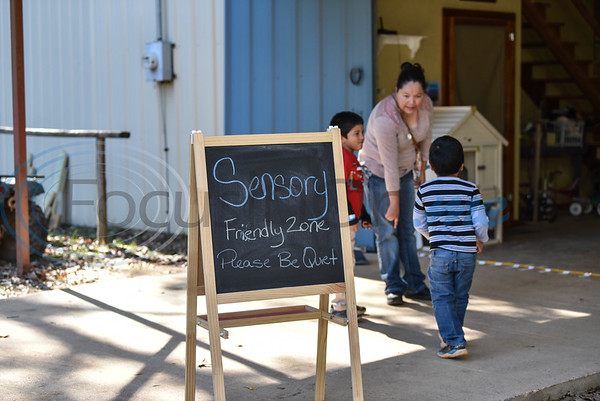 A sign sits outside a designated barn at a Fall Festival hosted by Elijah's Retreat in Jacksonville on Saturday. The Fall Festival is one way the retreat raises money to keep costs at a minimum for families touched by autism who are looking to unplug and build lasting memories in a sensory-friendly environment.  (Jessica Payne/Tyler Morning Telegraph)