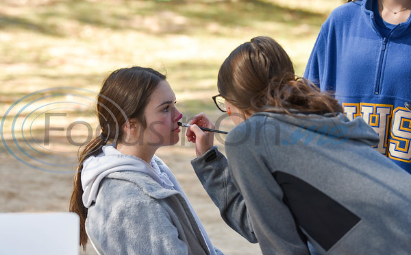 Jacksonville High School student Hadley Hillencamp gets her face painted at Elijah's Retreat Fall Festival celebrating 10 years in business. The event raised money, in part, with an auction that included ballet tickets to the Nutcracker, dove hunt for four in Argentina, American flag made from Fire Department retired hoses and more. (Jessica T. Payne/Tyler Morning Telegraph)