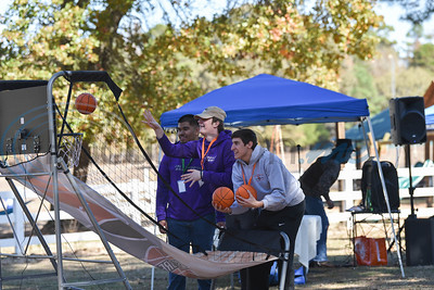 Jacksonville students shoot baskets while attending a Fall Festival hosted by Elijah's Retreat on Saturday in Jacksonville. (Jessica T. Payne/Tyler Morning Telegraph)