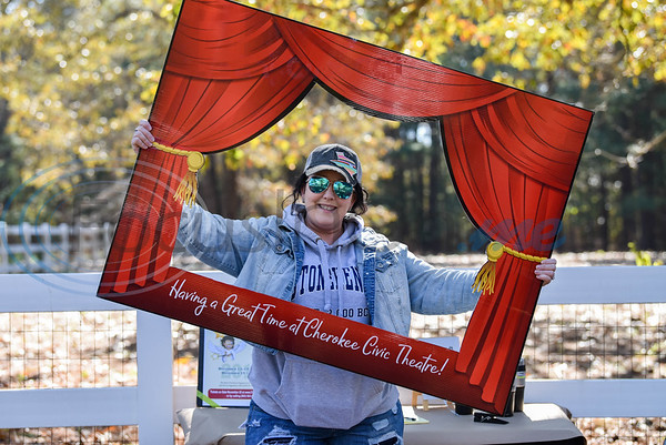 Josie Fox with the Cherokee Civic Theatre smiles for a photo at Elijah's Retreat Fall Festival on Saturday. The event helps raise money for the retreat which caters to families with children affected by autism. (Jessica T. Payne/Tyler Morning Telegraph)