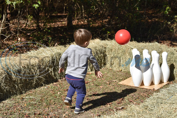 Jackson Jones, 2, attempts to throw a strike at a Fall Festival hosted by Elijah's Retreat on Saturday in Jacksonville. (Jessica T. Payne/Tyler Morning Telegraph)
