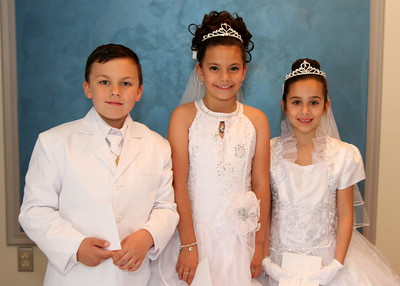 Eliyanna, Quiana, and Larry IV First Communion