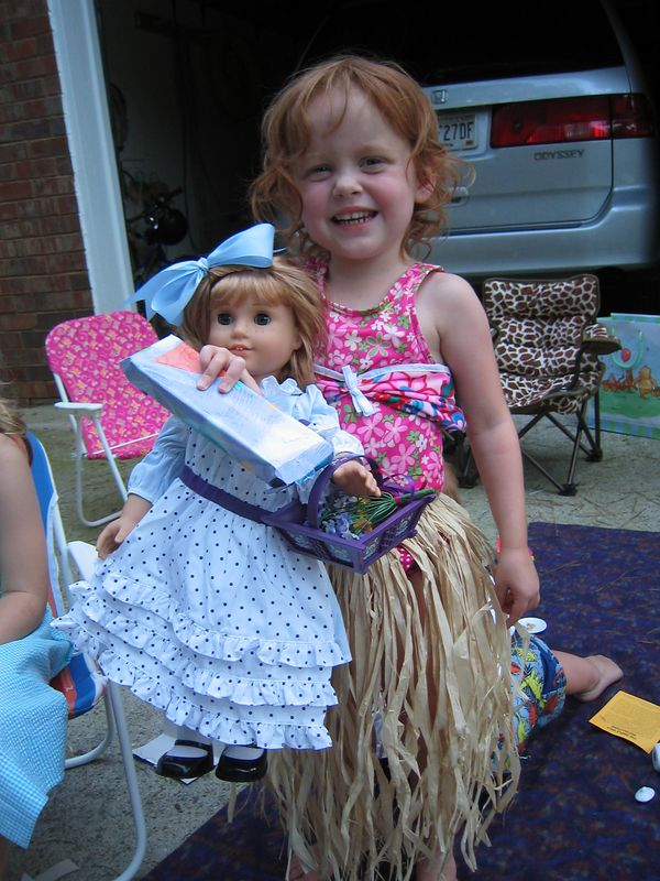 Elizabeth got this pretty dress and flower basket from her Great Grandmother and Great Grandfather.  She was thrilled!