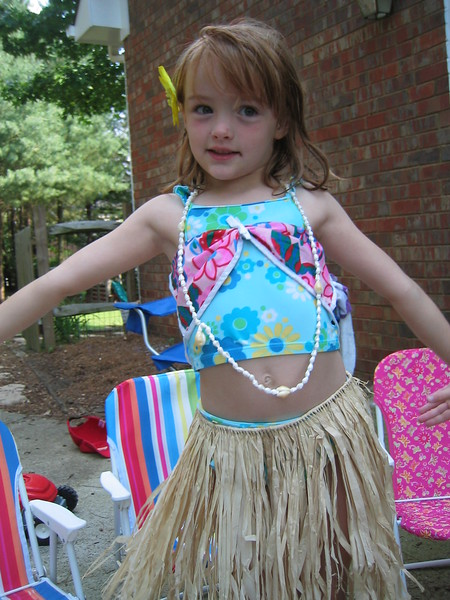 Caroline wanted to try out the grass skirt from Granddad and Nana first.  Caroline started dancing right away.  She loved it.  Elizabeth was not sure what to make of it at first.